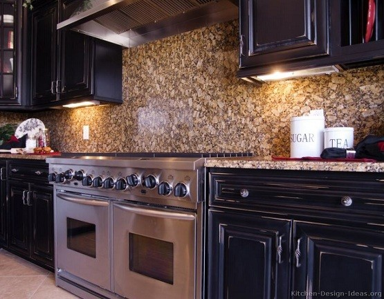 Distressed black kitchen cabinets with granite wall tile for Dark kitchen designs