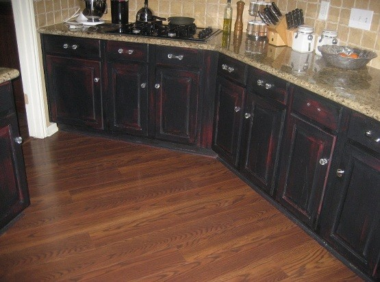 Distressed black kitchen cabinets with red color shadowing for Black kitchen cabinets images