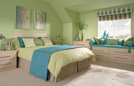 green bedroom with blue accent home interiors