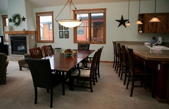 large dining table and extra seating at the bar home