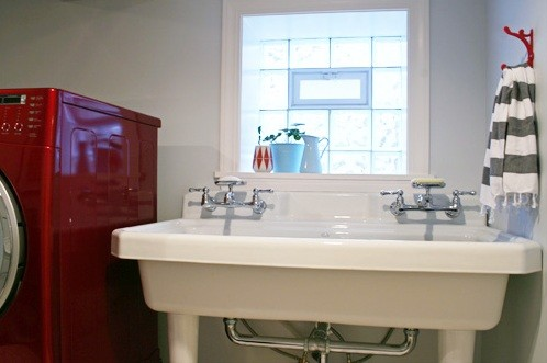 Large utility sink laundry room with double faucets