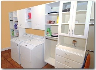 Custom and well-organized utility cabinets laundry room