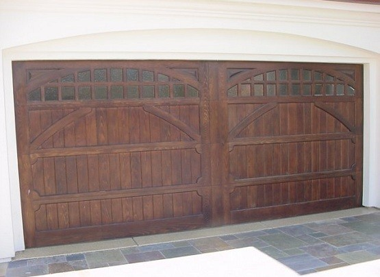 Carriage house style garage doors for remodeling project for Wood stained garage doors