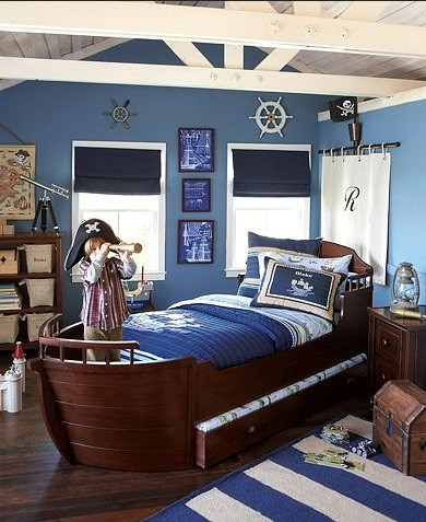 Blue color for boys bedroom with pirate style of decor