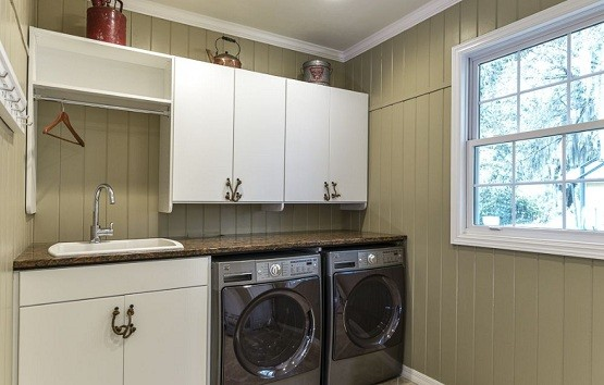 Cabinet Over The Dryer As Laundry Room Storage Solutions