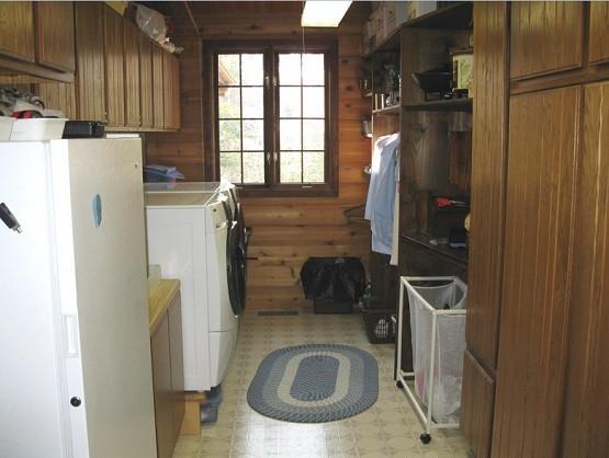 Open pantry shelving laundry room