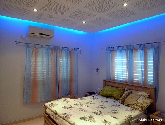 Master Bedroom With Blue Recessed Lighting