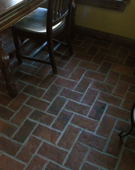 Dining room interior brick flooring with wax