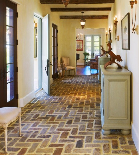 Interior brick flooring with wax in the middle room