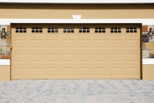 Double size garage doors with glass window