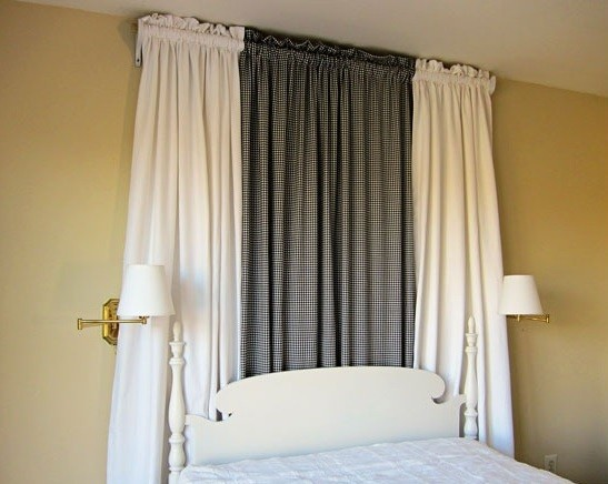 Black and two pieces of white cotton duck drapes for bed canopy