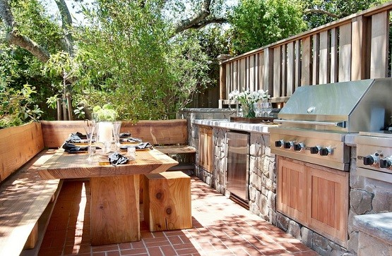 Outdoor kitchen with long dining room table
