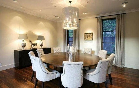 Round table with tufted dining room chairs