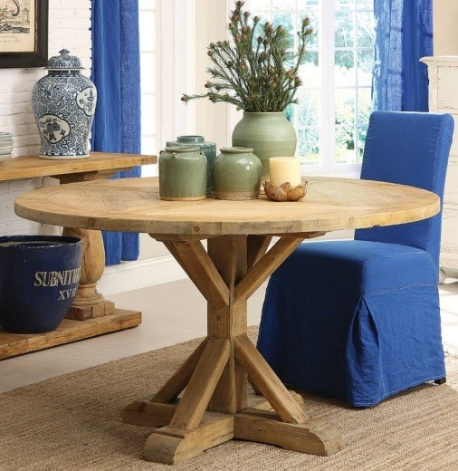 Round farmhouse table with blue skirted dining chair