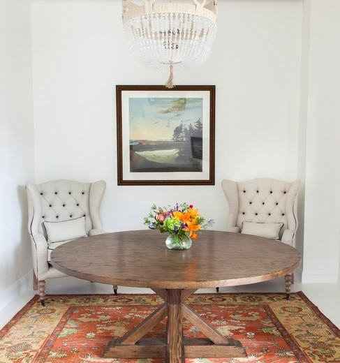 Round farmhouse table with high back sofa dining chair
