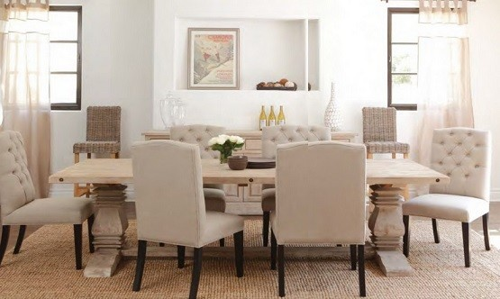 Distressed wood dining table with brown chairs