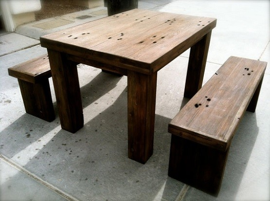 Stained distressed wood dining table with benches