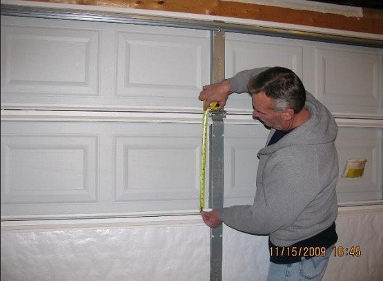 Measuring and cutting the garage door insulation panels
