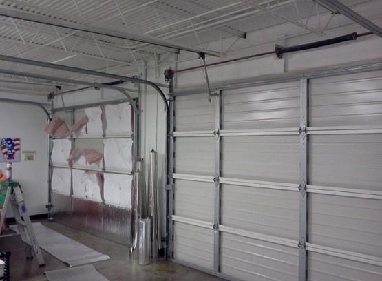 Overhead garage door insulation panels