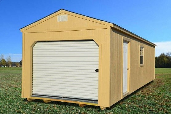 Portable metal garage with roll up doors