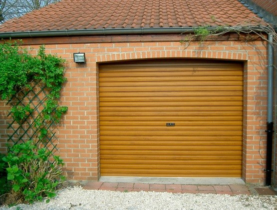 Yellow residential roll up garage doors