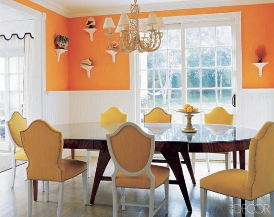 Simple dining room with white and orange color for dining