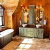 Rustic bathroom lighting on top of wooden vanity