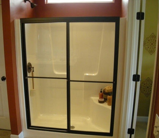 Black framed bypass shower stall doors with clear glass
