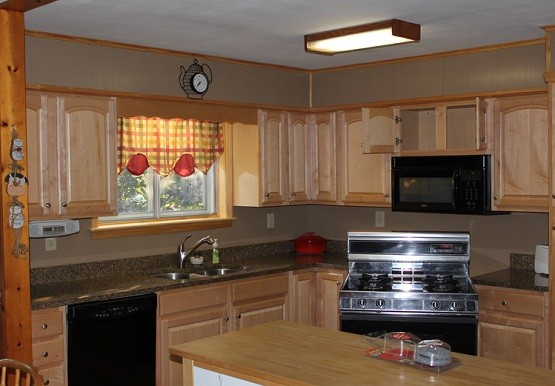 Unfinished kitchen cabinet with fluorescent light fixtures for kitchen