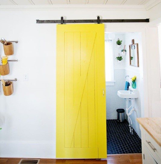 Yellow interior sliding barn doors for bathroom