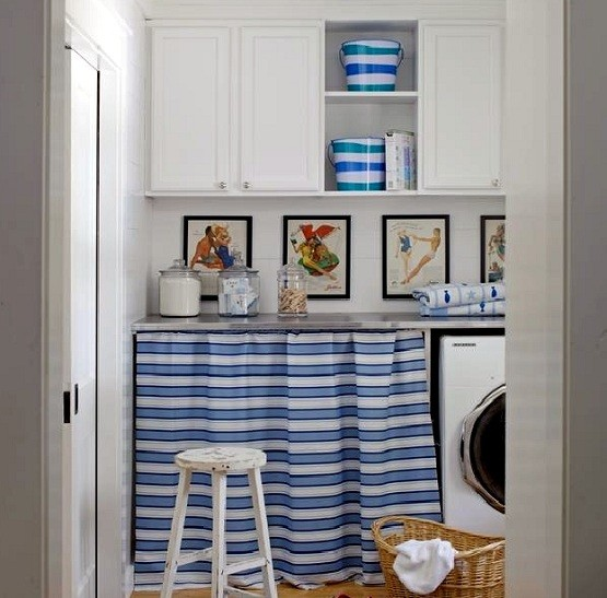 White laundry room cabinet ideas with hanging photos