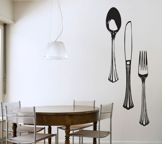 Black fork and spoon wall decor in dining room