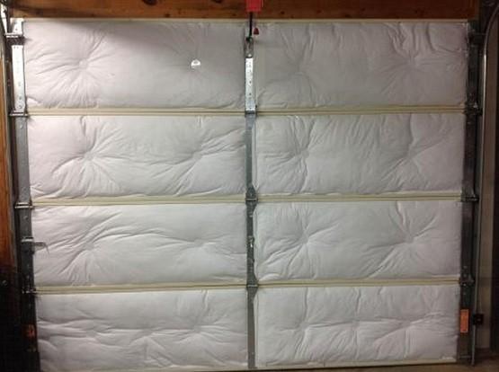 Garage door insulation panels with batt insulation