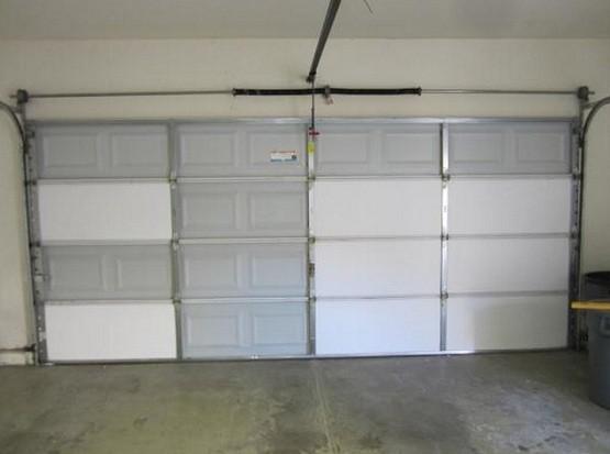 Garage door insulation panels with foam board insulation