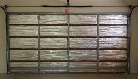 Garage door insulation panels with foil insulation