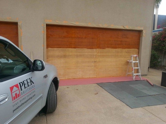 Preparing wooden garage door for painting