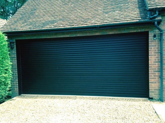Roller double garage door size with black paint finish