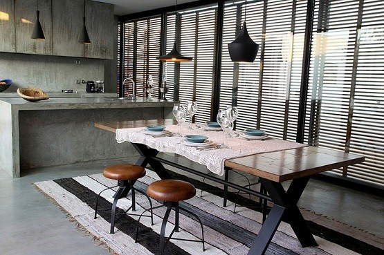 Modern industrial dining room lighting design with antique dining table
