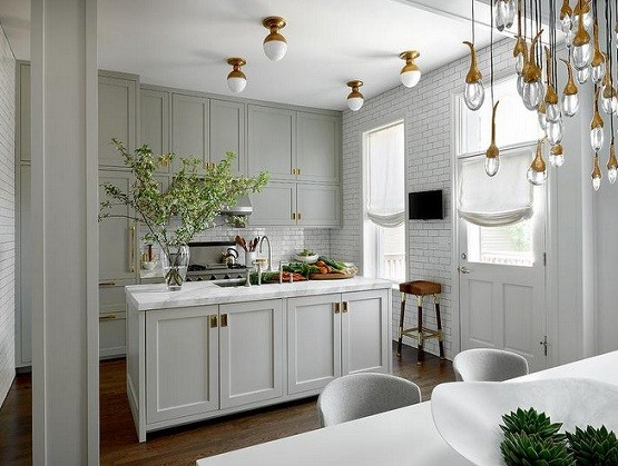 White kitchen with gold vintage flush mount lighting