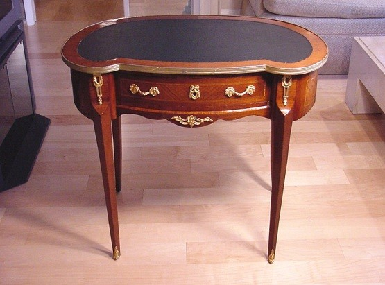 Kidney shaped desk with unique drawer