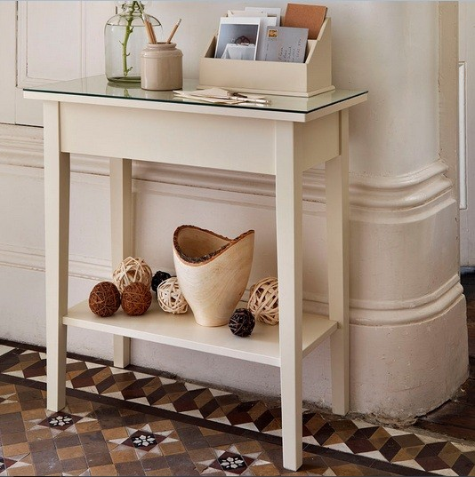 To fill the plain wall, you can hang a wide mirror in round shape on it.  With this decorative mirror above the white table, your hallway will not  look as ...