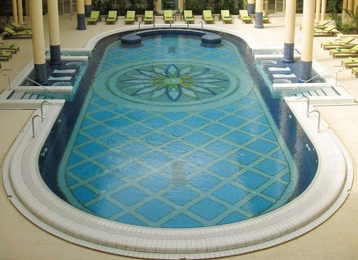 Decorative pool tiles ideas for oval pool designs