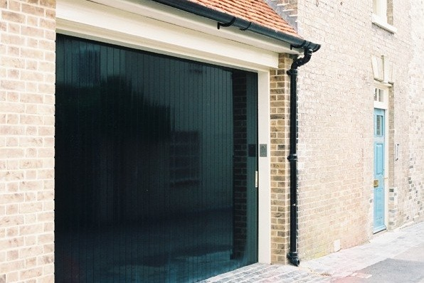 Sliding Garage Door Metal With Black Glossy Paint Finishes Home