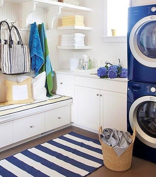White shelves & storage on beach themed laundry room   Home Interiors